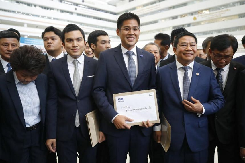 Thai Raksa Chart Party leader Preechapol Pongpanich (centre) along with his party members arrive for the election registration at the Election Commission in Bangkok, on Feb 8, 2019.
