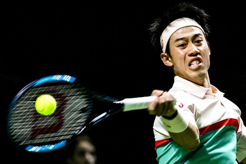 Nishikori in action during his first-round match against Pierre-Hugues Herbert of France.