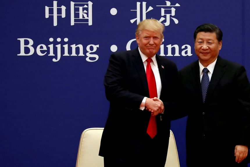 Trump (left) and Xi at a meeting with business leaders  in Beijing in 2017.