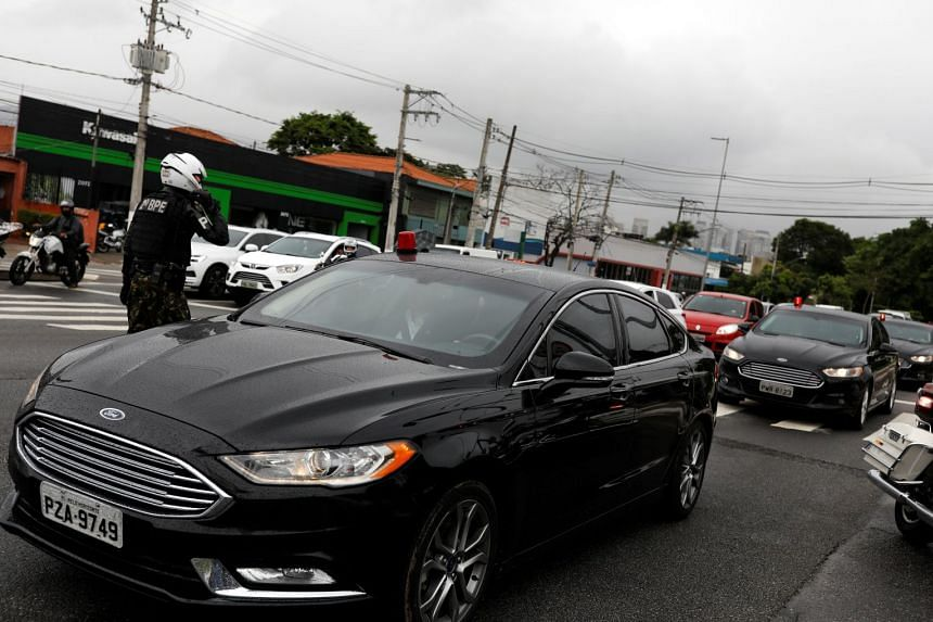 A convoy of vehicles transporting Bolsonaro is seen after leaving Albert Einstein Hospital in Sao Paulo.