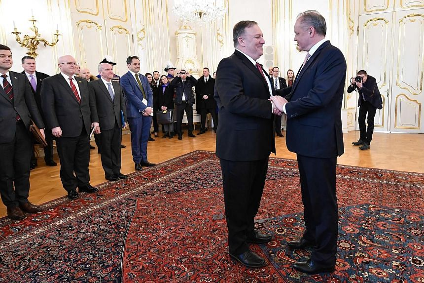 US Secretary of State Mike Pompeo (left) being greeted by Slovakia's President Andrej Kiska in Bratislava yesterday, during his week-long tour across central Europe.