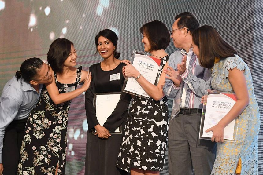 Ms Siti Noor Mastura being congratulated by fellow nominees (from left) Kenneth and Adeline Thong, Teo You Yenn, Robert Chew and Elizabeth Tan after being named The Straits Times Singaporean of the Year for 2018 at the Istana yesterday. The co-founde