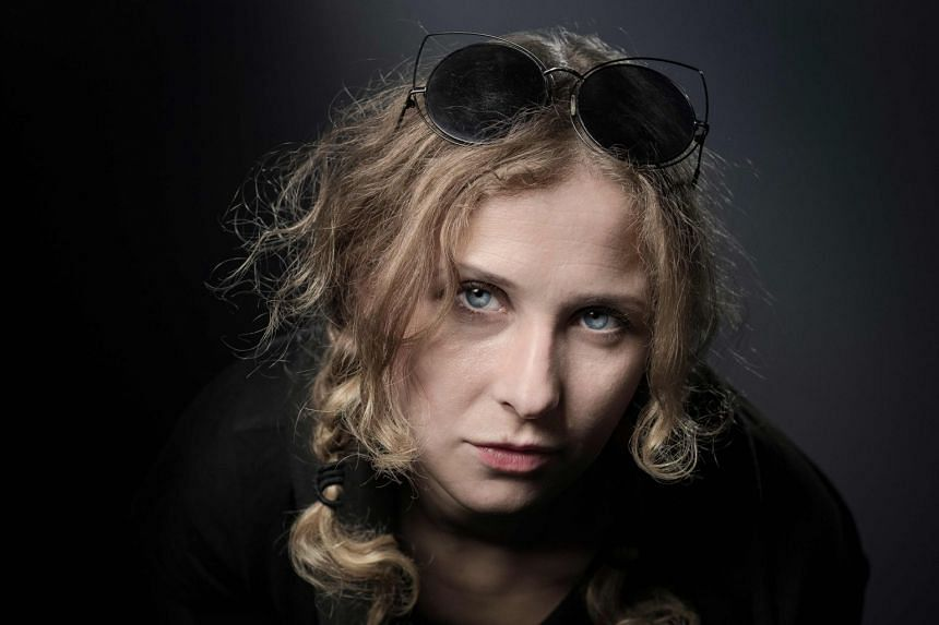 Maria Alekhina (above) and Kyril Masheka were so drunk on a flight to Milan that the pilot called the police.