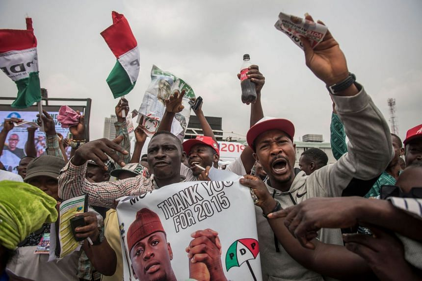 PDP supporters attend a campaign rally at Tafawa Balewa square in Lagos on Feb 12, 2019.