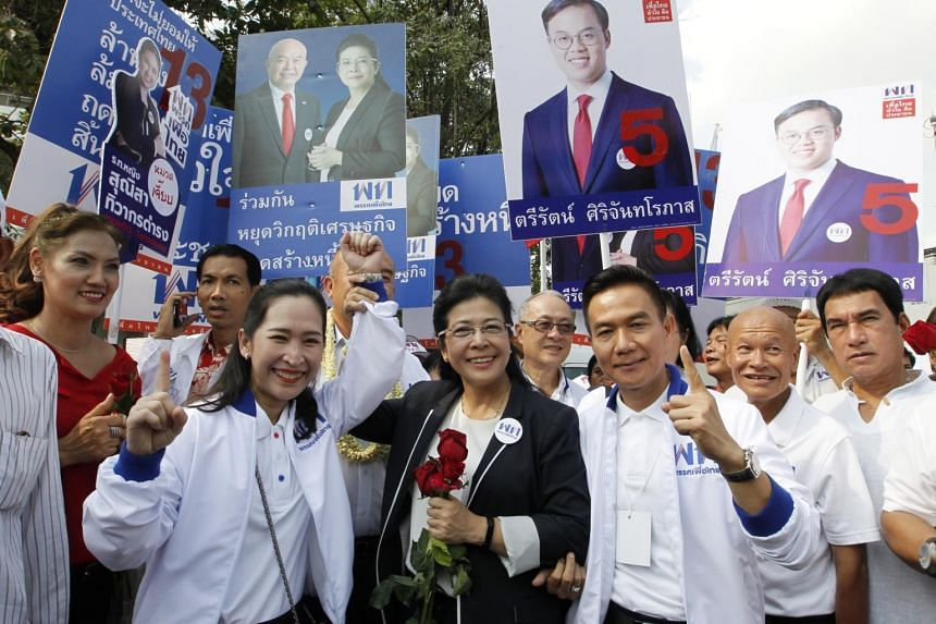 Pheu Thai political party chairwoman Sudarat Keyuraphan (centre) and the party's candidates pose for a photograph during the registration of candidates for constituency at Thai-Japanese stadium in Bangkok, Thailand on Feb 4, 2019.