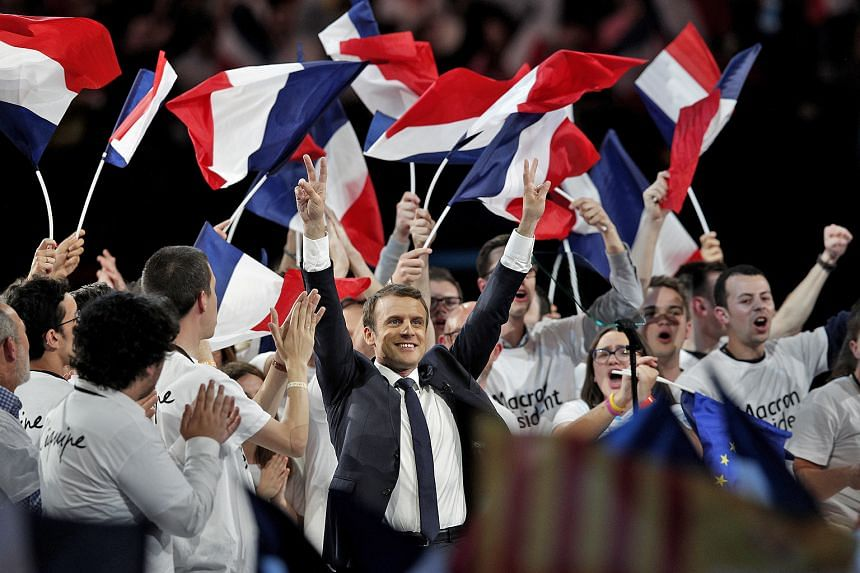 Then presidential candidate Emmanuel Macron at a campaign rally in Paris during the 2017 French presidential election. Foreign actors leaked hacked data from Mr Macron's campaign just two days before the second round of voting.