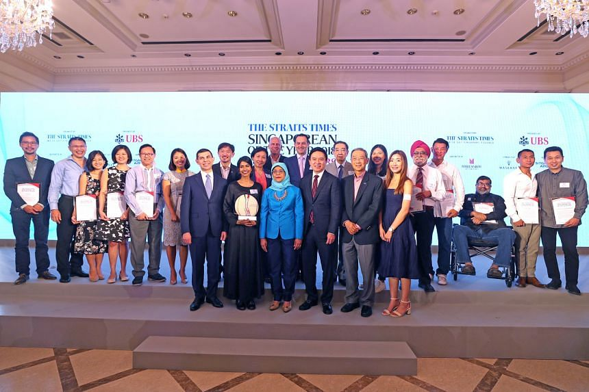 (From left) Straits Times editor Warren Fernandez, ST Singaporean of the Year 2018 winner Siti Noor Mastura, President Halimah Yacob and UBS Asia Pacific president Edmund Koh at the ceremony. Ms Noor Mastura's award citation recognised her for overco