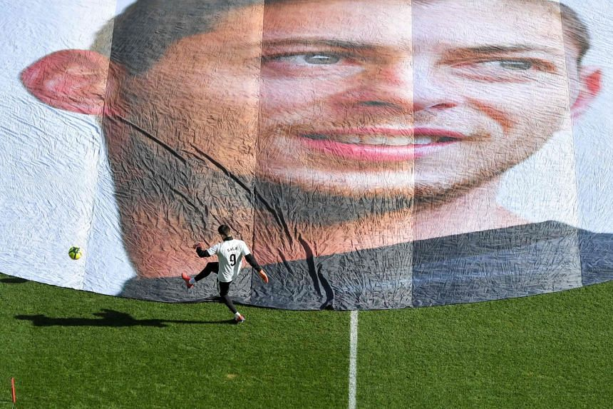 A player trains in front of Sala's portrait prior to the French L1 football match between Nantes and Nimes Olympique.