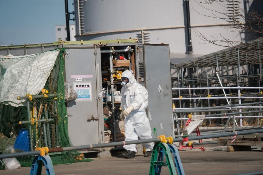 A Power Plant worker wearing gas mask and white suit in Fukushima Dai-Ichi power plant on Feb 14, 2018.