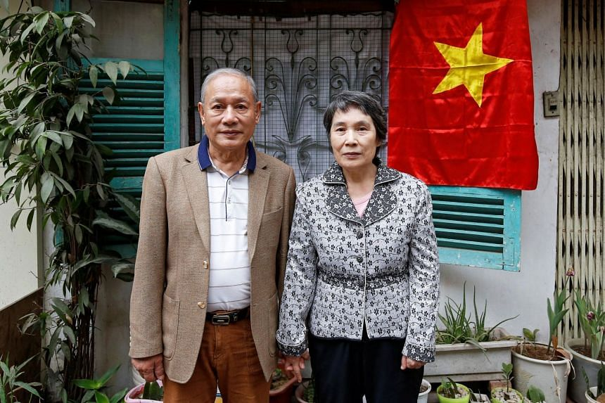 Vietnamese Pham Ngoc Canh who studied in North Korea and his North Korean wife Ri Yong Hui stand in front of their house in Hanoi, Vietnam on Feb 12, 2019.