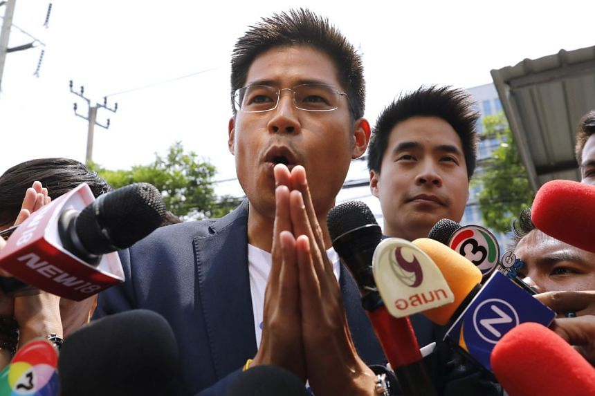 Thai Raksa Chart party leader Preechaphol Pongpanit makes the traditional Thai gesture of respect while speaking to journalists on arrival at the party headquarters in Bangkok on Feb 12, 2019