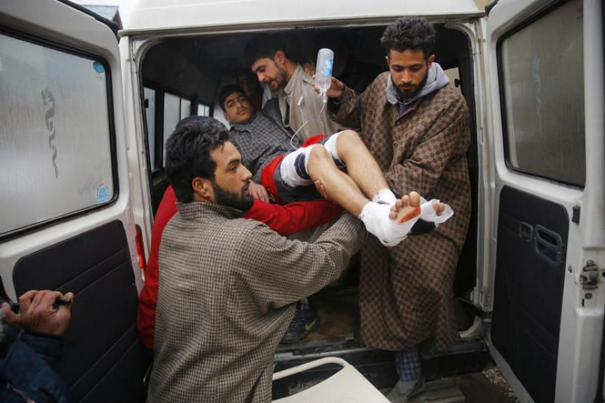 An injured student being lifted out of an ambulance at a local hospital in Srinagar, Kashmir on Feb 13, 2019.