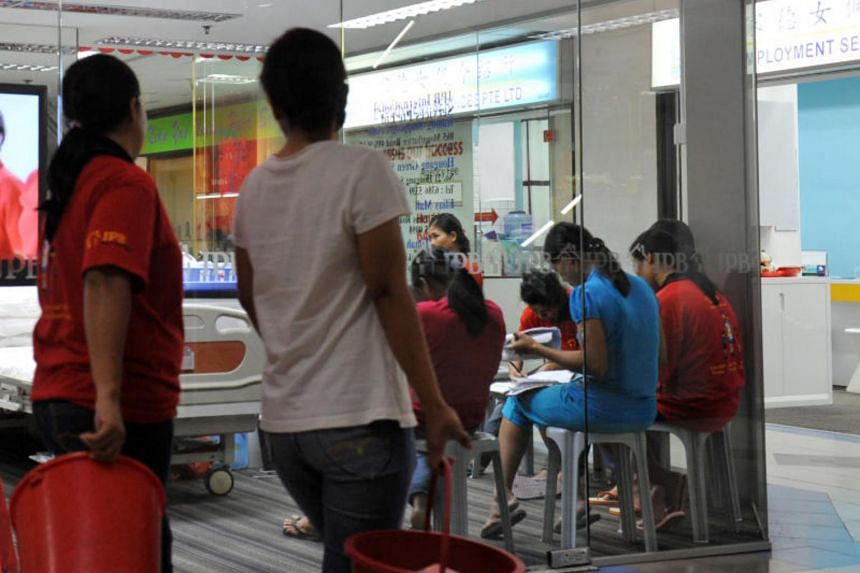 Maids are undergoing training, seen seated inside a maid agency at Bukit Timah Shopping Centre.