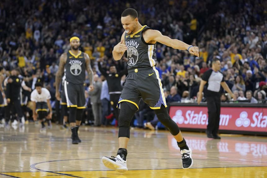 Golden State Warriors guard Stephen Curry celebrates after making a three-point basket during the fourth quarter against the Utah Jazz at Oracle Arena on Feb 12, 2019.