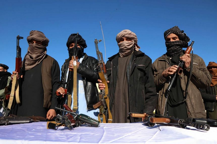 Former Taleban militants surrender their weapons during a reconciliation ceremony in Herat, Feb 5, 2019.