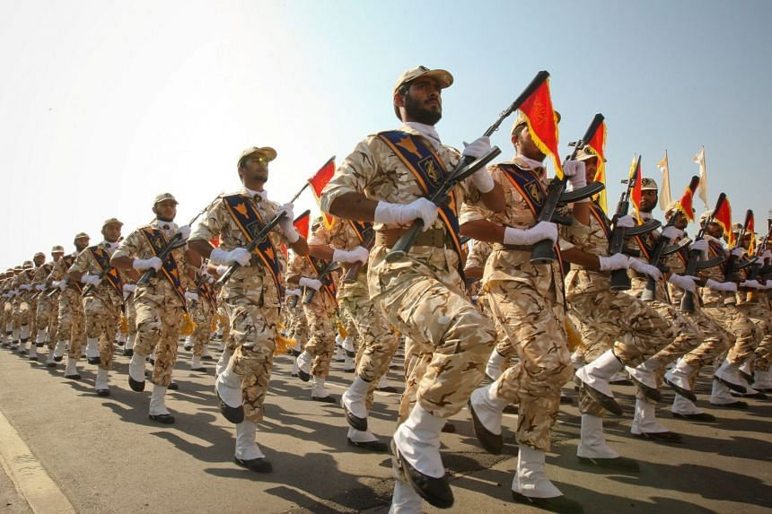 Iranian Revolutionary Guards march during a parade to commemorate the anniversary of the Iran-Iraq war.