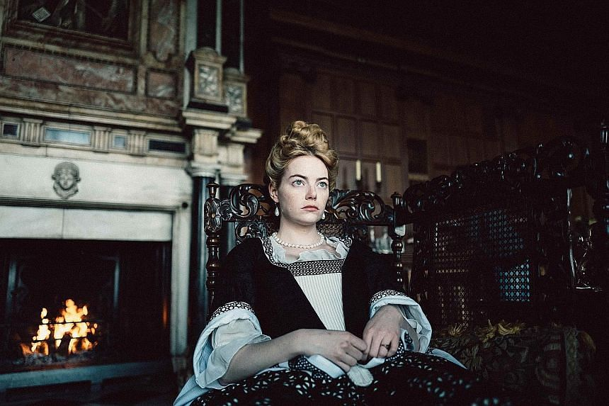 Actress Emma Stone (above) in The Favourite.