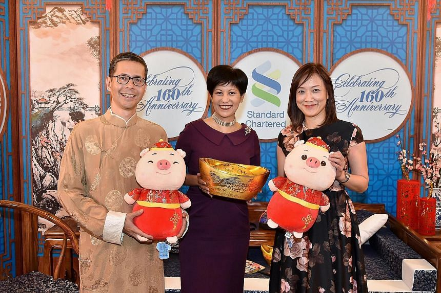 It's double happiness for Standard Chartered as the bank ushered in the Year of the Pig and marked its 160th anniversary in Singapore yesterday. At the event was guest of honour Indranee Rajah (centre), Minister in Prime Minister's Office and Second
