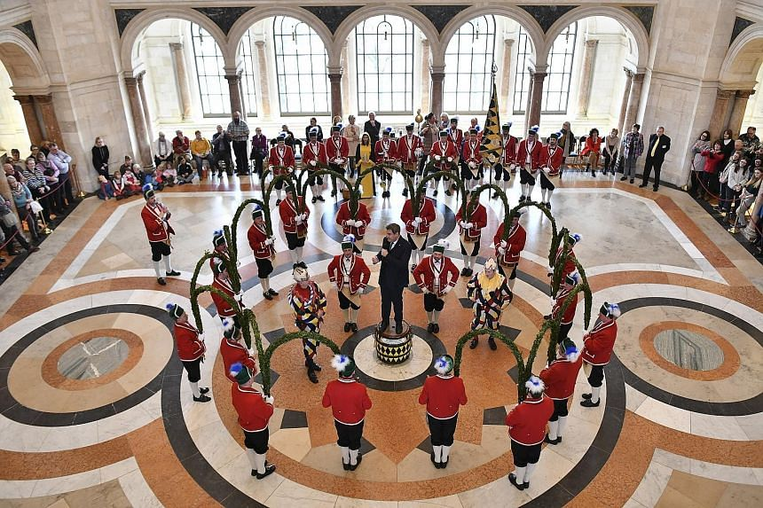 Bavaria's state premier Markus Soeder speaking to traditional Schaeffler dancers on Tuesday during a reception at the state chancellory in Munich, Germany. The barrel-makers' dance dates back to the 16th century when half of Munich suffered from the