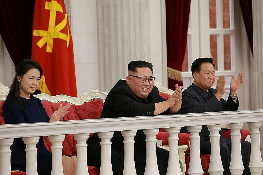 North Korean leader Kim Jong Un (centre) and his wife, Ms Ri Sol Ju, watching a performance in Pyongyang last week. He is due to meet US President Donald Trump for a second summit, in Hanoi, in a fortnight.
