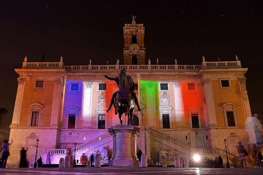 The colours of the French and Italian flags being projected on the Campidoglio in Rome in this Jan 30, 2016, photo. It marked the 60th anniversary an exclusive twinning agreement between Rome and Paris.