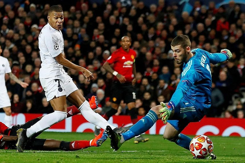 PSG forward Kylian Mbappe slotting past Manchester United custodian David de Gea for his team's second goal in the Champions League last-16, first-leg tie at Old Trafford on Tuesday.