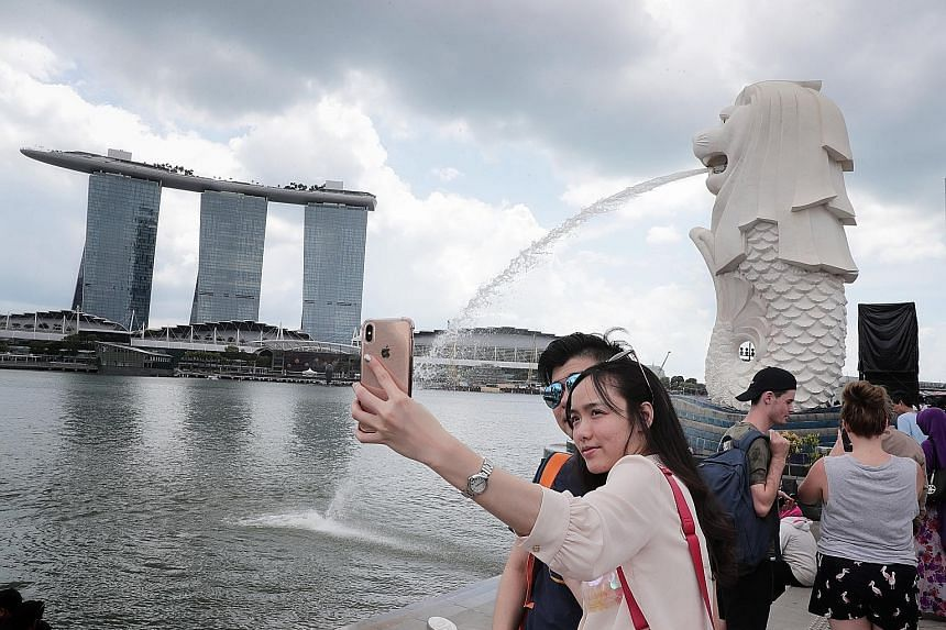 Married couple Tan Gui Ping and Lin Ming from Fujian, China, are visiting Singapore for the first time. China is the biggest source of tourists to Singapore, accounting for 3.4 million visitors who spent $3.16 billion between January and September la