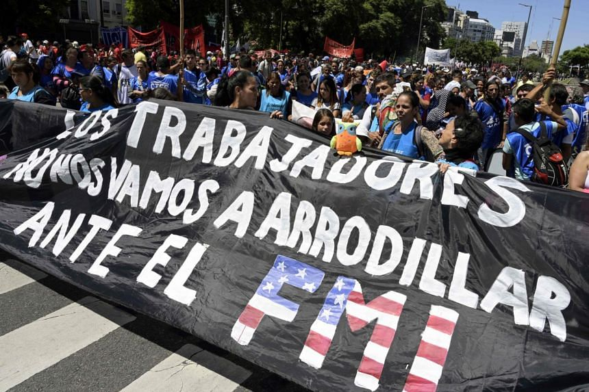 "Protests in Buenos Aires on Feb 13, 2019. The banner reads: ""We, the workers, will not kneel before the IMF (International Monetary Fund)."""