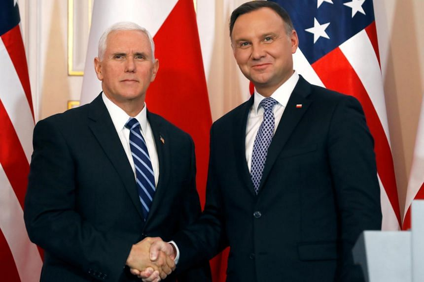 US Vice President Mike Pence (left) and Polish President Andrzej Duda at a joint news conference at Belvedere Palace in Warsaw, Poland on Feb 13, 2019.