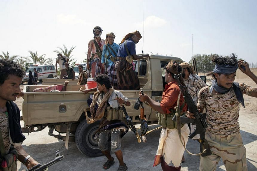 Injured Yemeni fighters, part of the Saudi-led coalition, arrive at a field hospital in Durayhimi, Yemen on Oct 6, 2018.