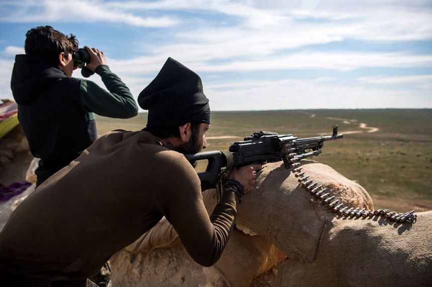 Fighters with the US-backed Syrian Democratic Forces during an operation to expel Islamic State group jihadists from the Baghouz area in the eastern Syrian province on Feb 13, 2019.
