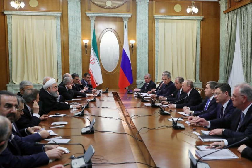 Iranian President Hassan Rouhani and Russian President Vladimir Putin meet for talks in Sochi, Russia, on Feb 14, 2019.