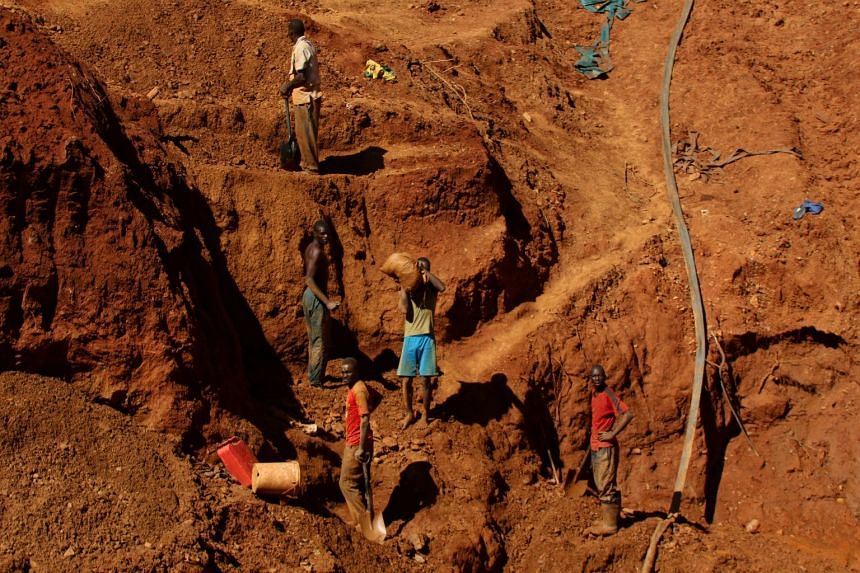 Illegal artisanal gold miners work at an open mine after occupying parts of Smithfield farm, owned by the former president Robert Mugabe's wife Grace Mugabe, in Mazowe, Zimbabwe, on April 5, 2018.