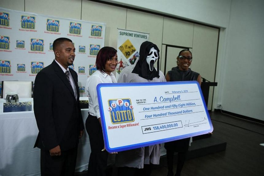 Game operator Supreme Ventures tweeted photos showing the lottery winner, identified only as A. Campbell - in costume - collecting his prize at the Spanish Court Hotel in Kingston, Jamaica, on Feb 5.