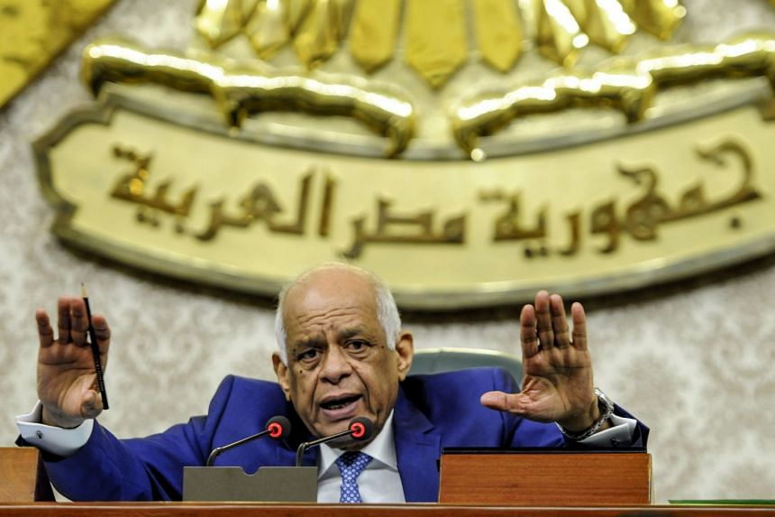 Egypt's Parliament Speaker Ali Abdel-Aal chairs a session to deliberate the proposed constitutional amendments.