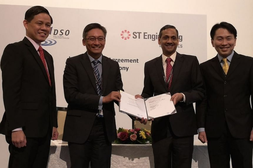 (Left to right): Minister for Trade and Industry Chan Chun Sing, DSO National Laboratories chief executive officer Cheong Chee Hoo, ST Engineering president of electronics Ravinder Singh, and ST Engineering president and chief executive officer Vince