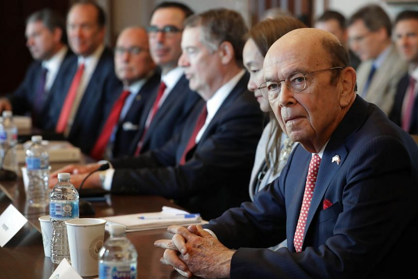 Wilbur Ross (far right) and other Trump administration officials sit down with Chinese vice-ministers and senior officials for trade negotiations in Washington.