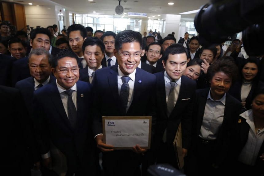 Thai Raksa Chart's leader Preechaphol Pongpanit (centre) said that the party acted with the best of intentions and is innocent, after the Election Commission recommended its dissolution.