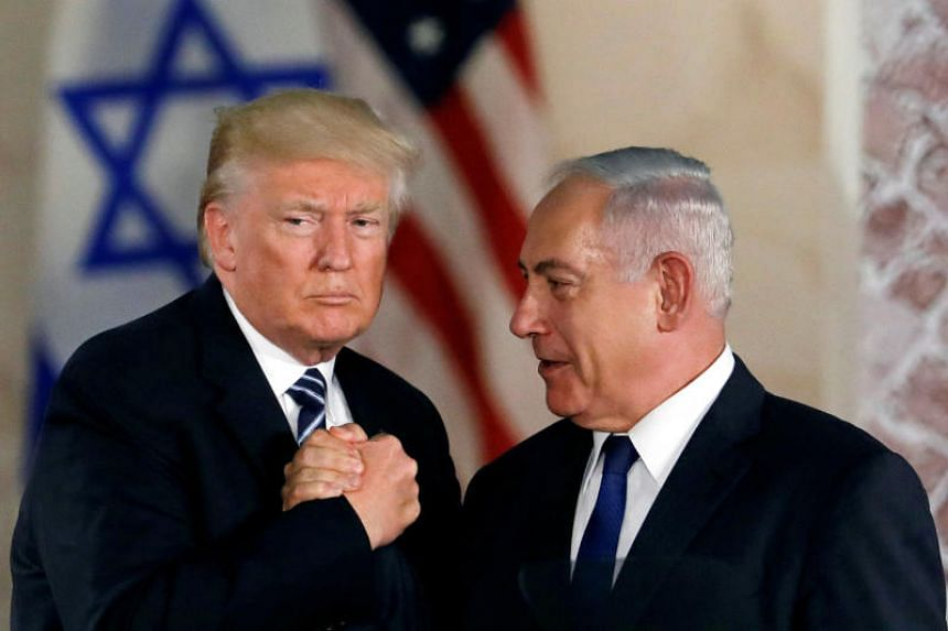 Election billboards feature Israeli Prime Minister Benjamin Netanyahu shaking hands with US President Donald Trump. The electorate has watched with delight as, under Mr Trump, Washington lined up with many of Mr Netanyahu's policies.