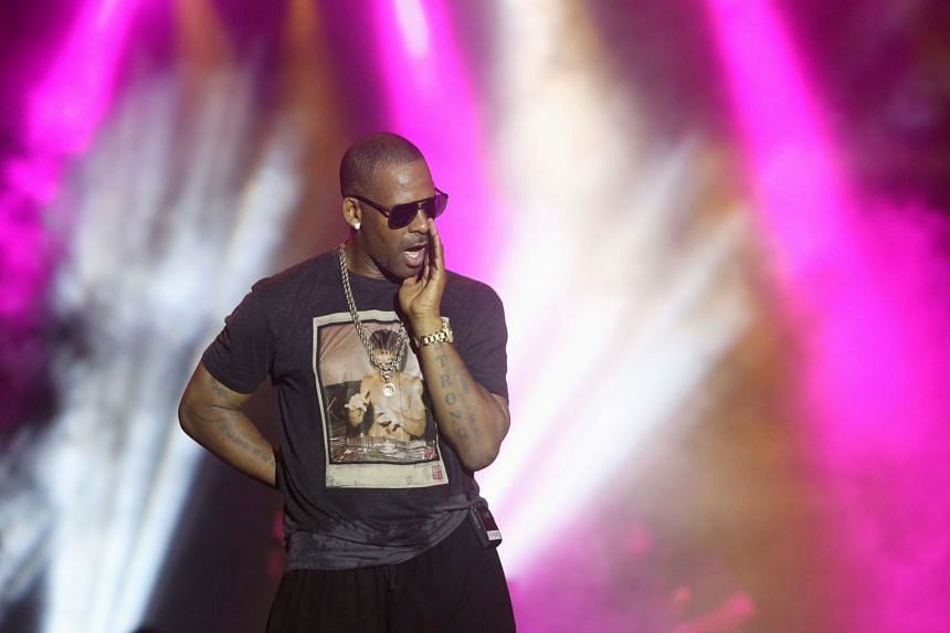 Singer R. Kelly talks to fans as he performs in Trinidad and Tobago in 2013.