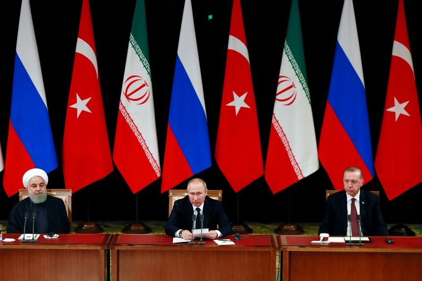 (From left) Iranian President Hassan Rouhani, Russian President Vladimir Putin and Turkish President Tayyip Erdogan attend a news conference.