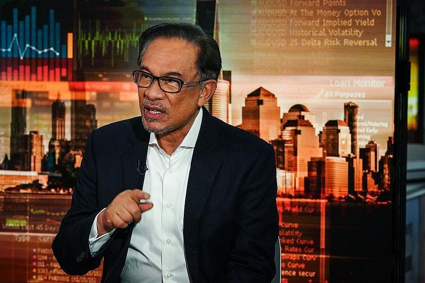 "On the 1MDB issue, Mr Anwar Ibrahim said Malaysia ""will not compromise"" in its talks with Goldman Sachs, and that the bank ""must bear responsibility""."