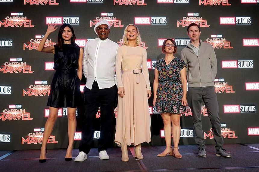 The cast of Captain Marvel (from far left) Gemma Chan, Samuel L. Jackson and Brie Larson, together with the film's directors, Anna Boden and Ryan Fleck, at a press conference at Marina Bay Sands Expo and Convention Centre yesterday.