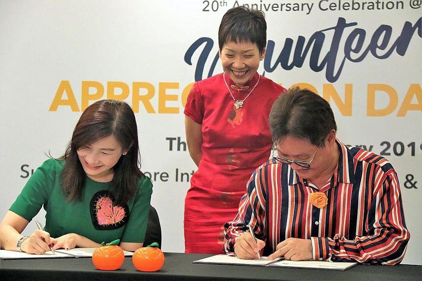 Standard Chartered Bank regional head of corporate affairs and branding and marketing Eva Ang and RSVP Singapore chairman Koh Juay Meng signing the memorandum of understanding yesterday, witnessed by Minister for Culture, Community and Youth Grace Fu