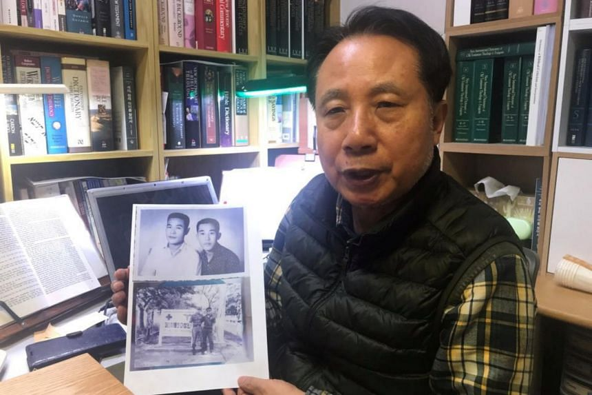 Mr Ahn Yong-soo with a picture of his brother, who was a South Korean prisoner of war captured by communist Vietnamese during the Vietnam War and handed over to North Korea.