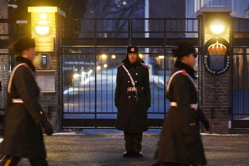 Paramilitary police officers patrol outside the Swedish embassy in Beijing on Feb 14, 2019. Swedish ambassador, Anna Lindstedt, is accused of arranging unauthorised, secret talks.