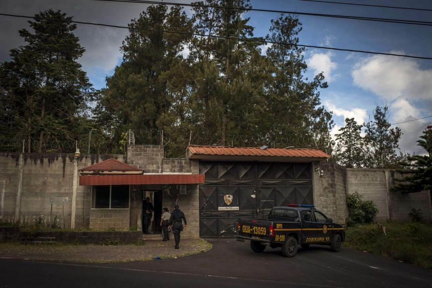 Officials arrive at the entrance to the youth shelter in San Jose Pinula, near Guatemala City, where 41 girls died in a March 2017 fire.
