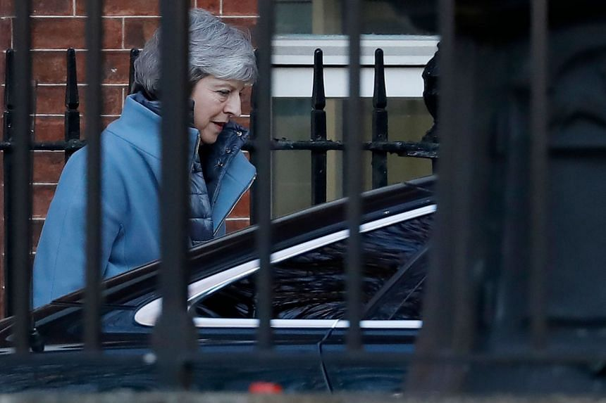 May leaves from the rear of 10 Downing Street in London on Feb 14, 2019, ahead of the vote.