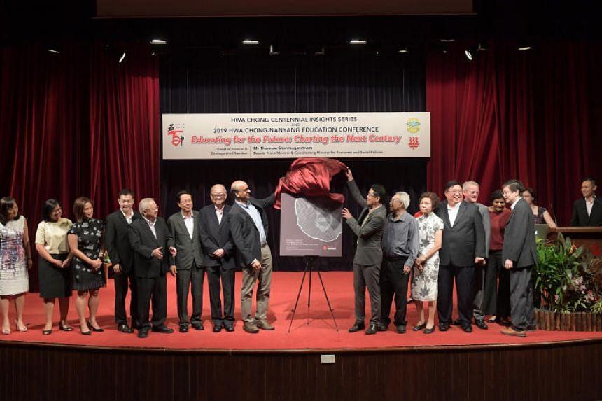 Deputy Prime Minister Tharman Shanmugaratnam and Hwa Chong Institution principal Pang Choon How launch the Hwa Chong Centennial Publication: A Tribute To The Hwa Chong Educator: 1919 - 2019 on Feb 15, 2019.
