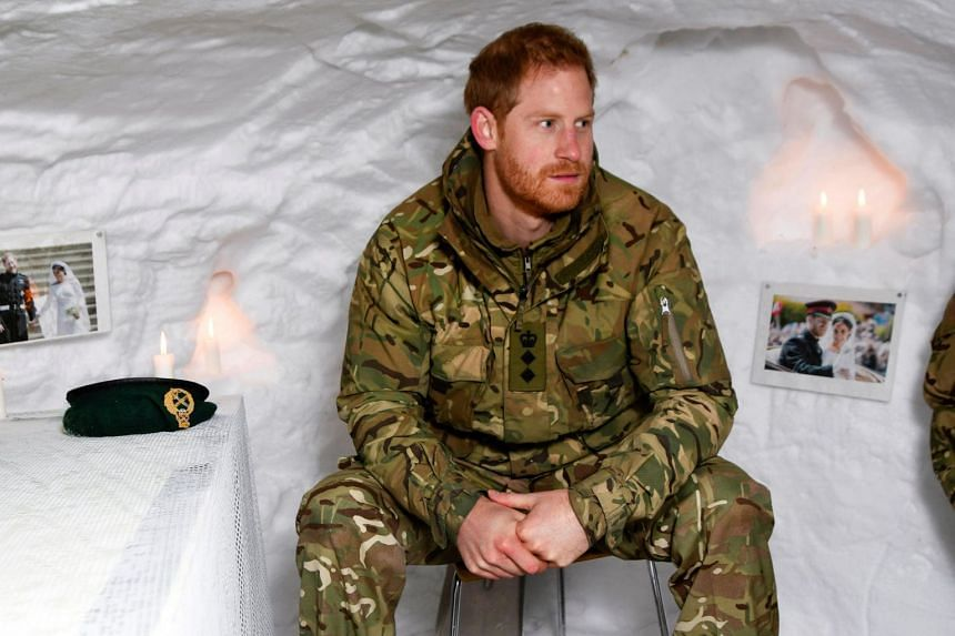 Britain's Prince Harry sits in a snow cave decorated with candles and his wedding photos during Exercise Clockwork in Norway, on Feb 14, 2019.